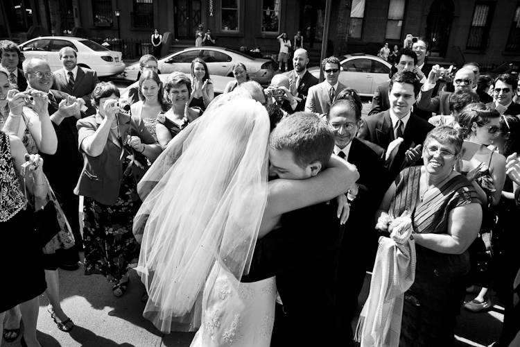 kissing and hugging bride and groom picture